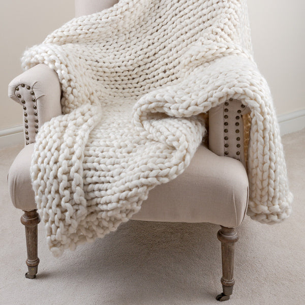 chunky knit throw in white on chair