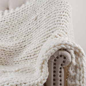 white chunky knitted throw