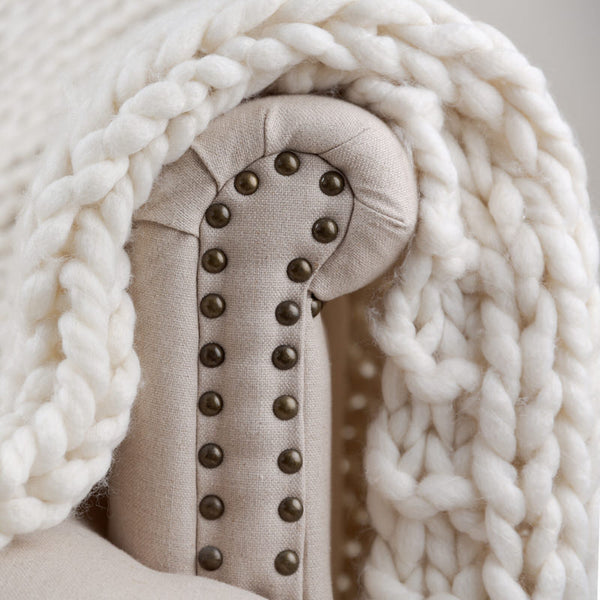 pattern of white chunky knit throw blanket