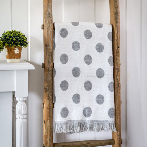 grey and white polka dot throw