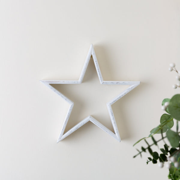 white wooden star hang on wall