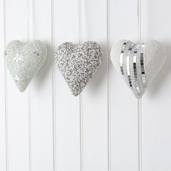 three hanging white heart decorations