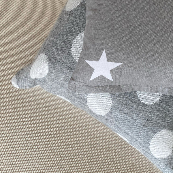 30cm x 30cm grey cushion with white star. Includes feather filled pad.
