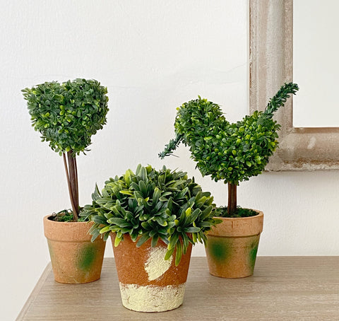 Set of three mini artificial topiary.