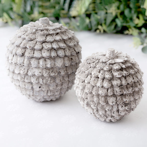 large and small rustic ceramic pine cone decorations