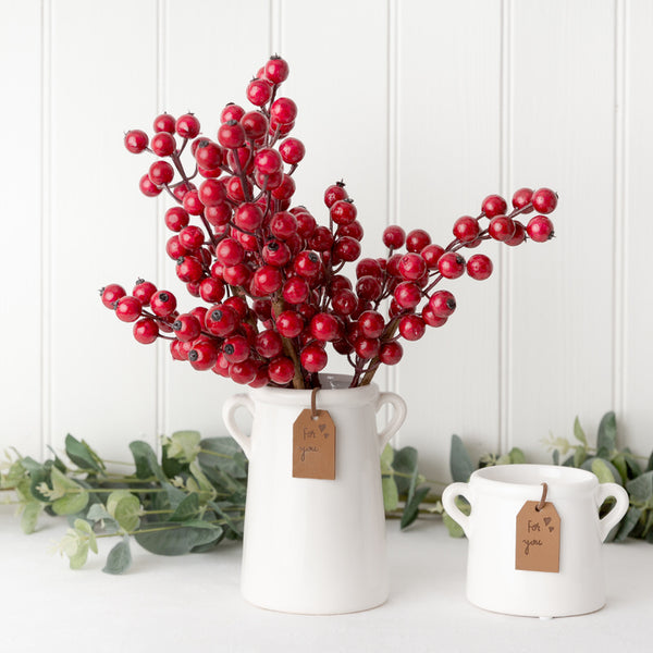 red berry stems in white ceramic milk churn pot planter