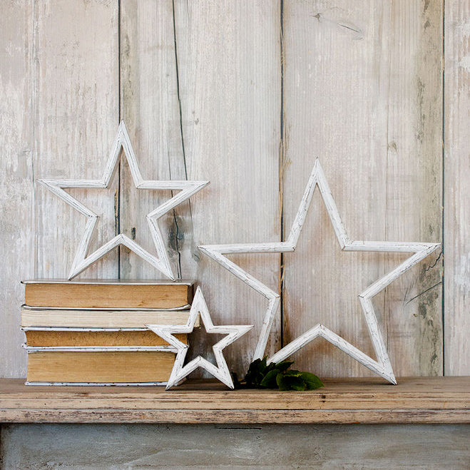 set of three white wooden rustic stars in various sizes