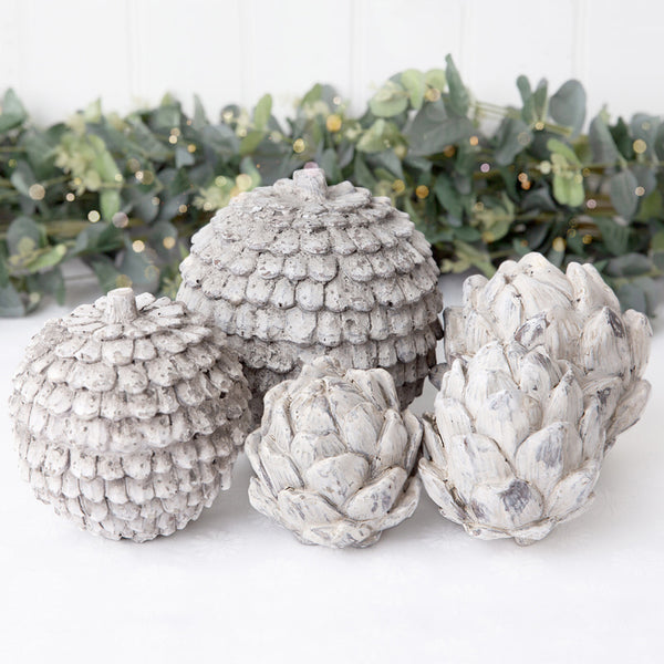 stone pine cone and artichoke ornaments in small and large
