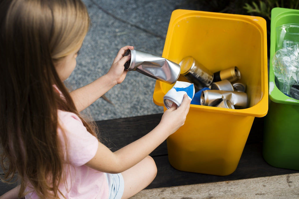 A girl sorting the recyclable rubbish