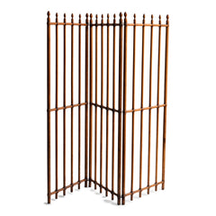 A particularly fine Arts & Crafts gated wooden screen consisting of three open panels.  Each panel is constructed from turned wooden spindles that pass through wooden crossbars - the whole resembling railings. Each spindle is topped with a turned acorn-shaped finial. The execution of the joinery and the pared-back design is pure Arts & Crafts.