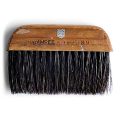Once used a wallpaper brush, this handy little brush is just at home being used in conjunction with dustpan or as a tabletop crumb brush.  Origin: UK  Date of manufacture: 1950  Material: pure bristle and wood  Length 20cm Width 13cm Depth (thickness) 3cm  Condition: good, with time-worn patina that comes with decades of use.