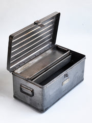 A very handsome 1940s military heavy-duty metal work box in stripped steel. The box is fitted with two internal rectangular steel trays; twin carrying handles and a hasp for a padlock.