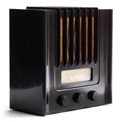 The British Murphy 4 valve AD 94  radio with distinctive Art Deco black Bakelite cabinet was manufactured from 1940.  Looking like a modernist building, this pioneering architectural style  radio resembles a powerhouse of electronic communications. Its streamline, futuristic mirrors  the Machine Age of the late 1930s.
