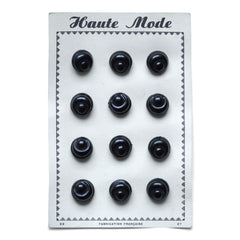 "We have several of these ""Haute Mode"" black buttons mounted on their original sales card. Each circular button is shaped like a mini bread roll and there are 12 in total on each card."