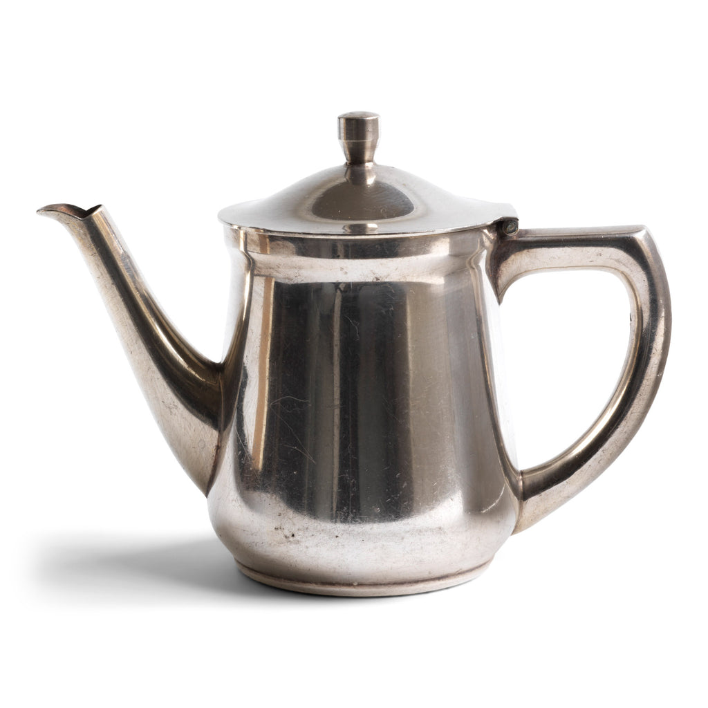 "A good, heavy-duty German WMF silver plated teapot stamped ""Wurtt Metall W Fabrik"", an abreviation for Württembergische Metallwarenfabrik ( Württemberg metal factory), and ""Geislingen Steig"", the southern German town where the factory was based.  It also bears an arrow mark, indicating it was for military use - and was most probably made for an English officer's mess."