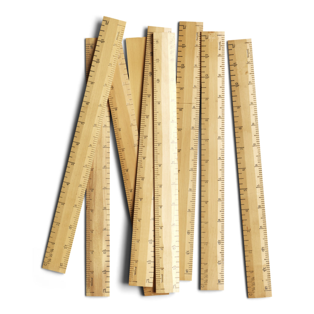 We have sourced a collection of vintage 1960s wooden rulers, each marked in imperial inches.