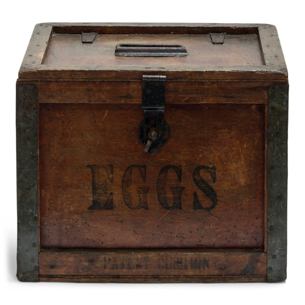 "A very handsome 1920s egg travelling box, recently purchased from a farm sale in Hertfordshire, UK. The lid, and all four side panels are stencilled ""Eggs"", and various extra stamps, as shown in the images. It has a bracket hinged lid with carrying handle, reinforced metal trim corners, and a hasp. Inside the lid it still has its original maker's paper label, applied by the ""Dairy Outfit Company Ltd, Kings Cross, London N1""."