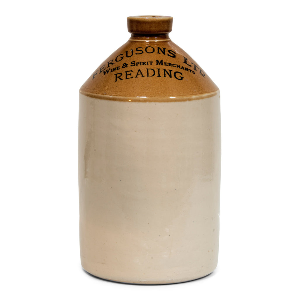 "A large Victorian flagon with bold utilitarian nineteenth century typeface: ""Fergusons Ltd Wine & Spirit Merchants Reading""."