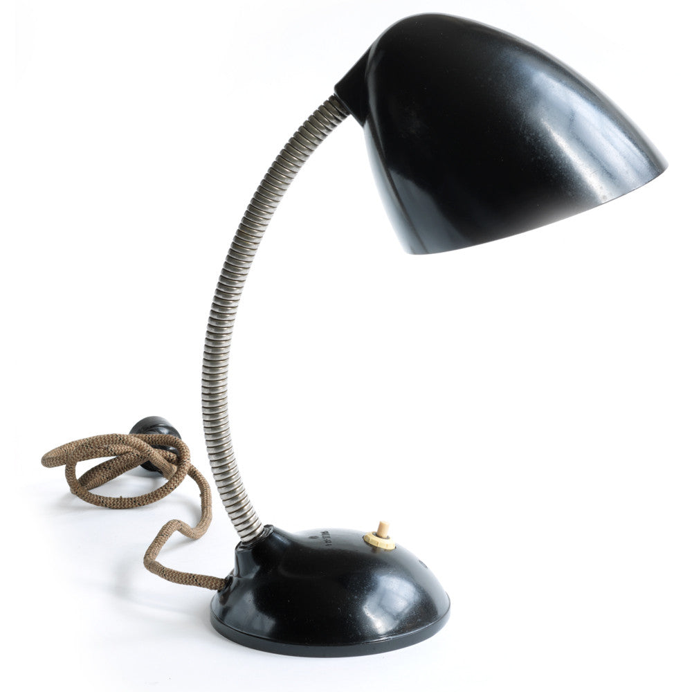 A stunning 1940s Bakelite lamp with flexi-arm designed by British designer Eric Kirkman Cole. It emits good directional light and so is ideal for the desk or the bedside table.
