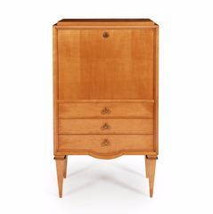 "A stunning 1940s satin birch secrétaire attributed to André Arbus. The plain fall front opens to reveal a fitted interior above three drawers and square tapering legs with decorative brass capitals. The centralised demi-lune detail of the lower drawer facade; the exaggerated taper of the squared legs, and their decorative brass capitals, are all hallmark Arbus design details and characteristic of the designer's peak, his 1940s ""neoclassique"" period."