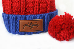 Close up of leather Platypus logo on Union beanie with removable pom