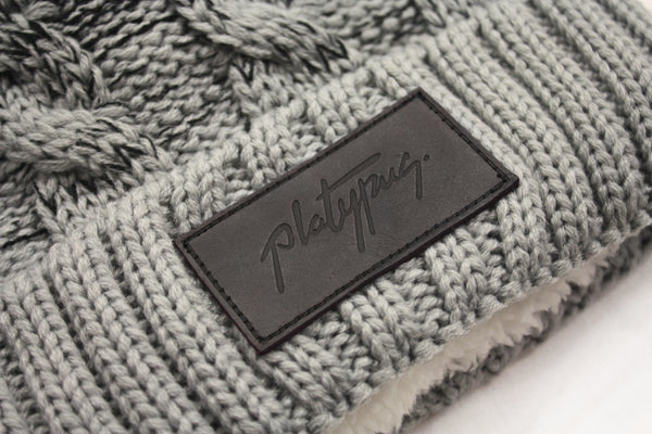 Close up of Leather Patch Black & Grey Ombre Knitted Beanie Hat | Free shipping from Platypus UK Streetwear Fashion