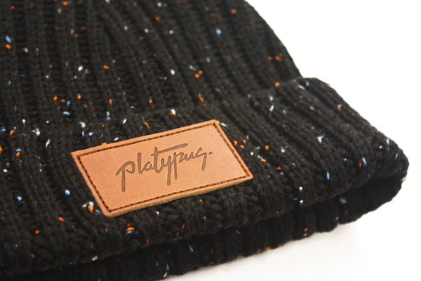 Platypus Leather patch close up on Black Speckle Knit Street Style Beanie Hat
