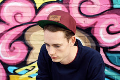 Model wearing Maroon Platypus Snapback Hat