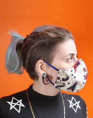 Side view of tattoo patterned fitted face mask