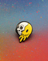 close up of 90s rave skeleton cartoon smiley face designer enamel pin badges