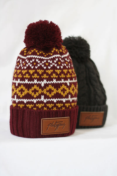 Platypus Nordic Pattern Knitted Beanie and charcoal cable knit leather beanie