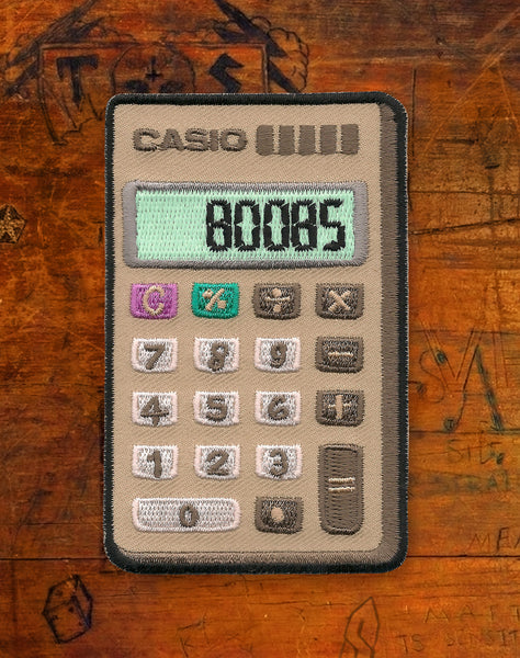 Boobs Casio Calculator (Glow in the Dark) Iron-on Patch by Maxine Abbott | Platypus Streetwear