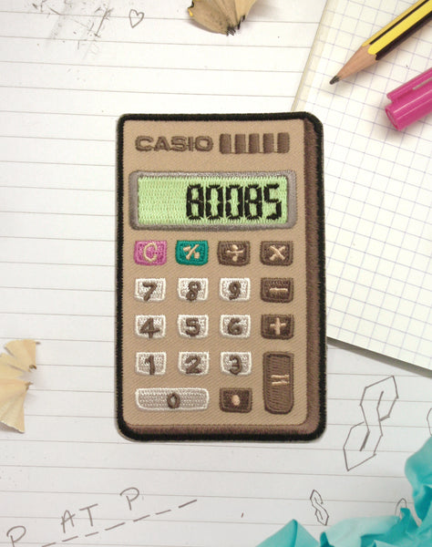 Boobs Casio Calculator (Glow in the Dark) Iron-on Retro Patch by Maxine Abbott | Platypus Streetwear Patches & Pins