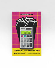 Nostalgic Glow in the Dark Boobs Casio Calculator Enamel Pin badge in packaging | Designer Maxine Abbott