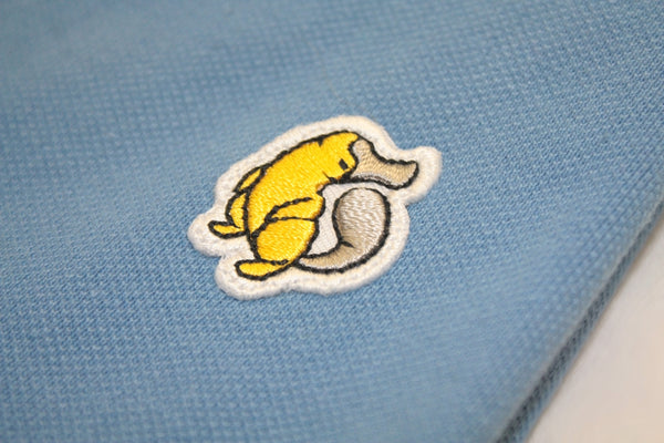 Emblem Close up on Rainbow Tipped Blue Platypus Emblem Polo Shirt