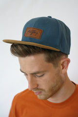 Platypus Headwear Close up of Denim and Suede Style Snapback Hat