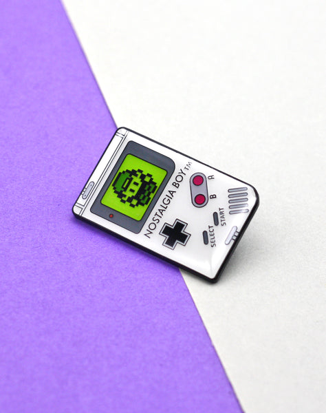 Close up Nostalgia boy 90s game boy parody enamel pin badge with glow in the dark screen