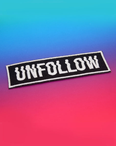 Angle view of unfollow glitched typography art goth punk best protest embroidered patch - badges for bags clothing and jackets