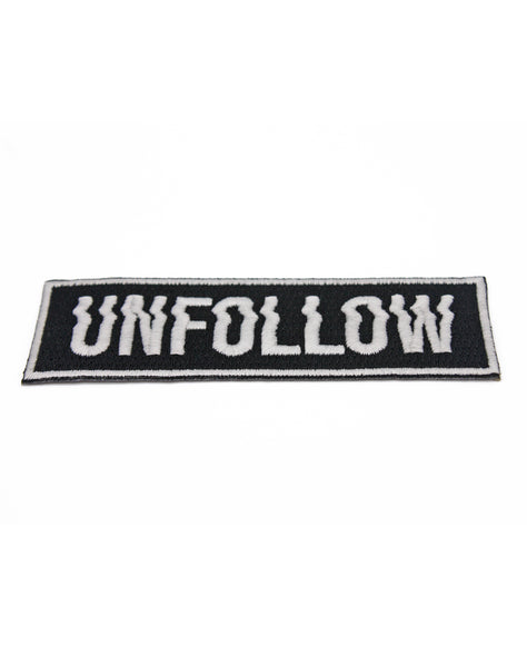 angle shot of glow in the dark unfollow type goth emo punk protest embroidered patches on white