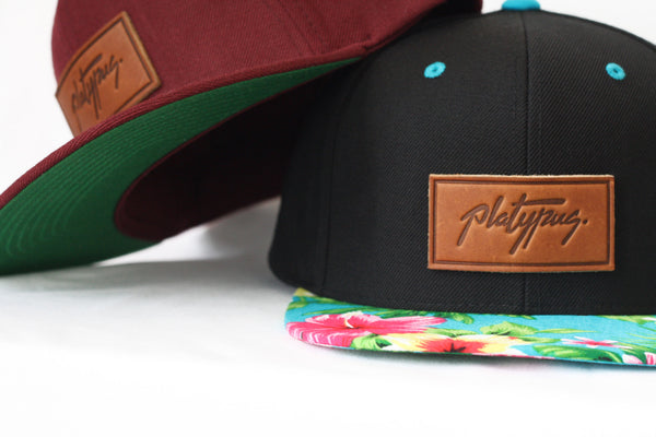 Underside of Maroon Platypus hat with Floral Snapback