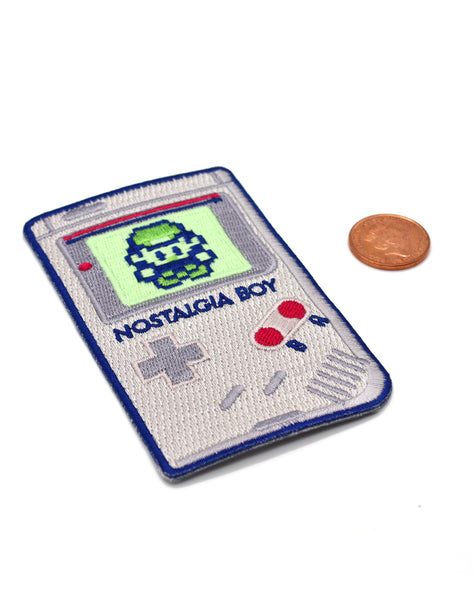 Close up of Glow in the dark Nostalgia boy game boy parody designer Iron-on Embroidered Patches to scale made in UK
