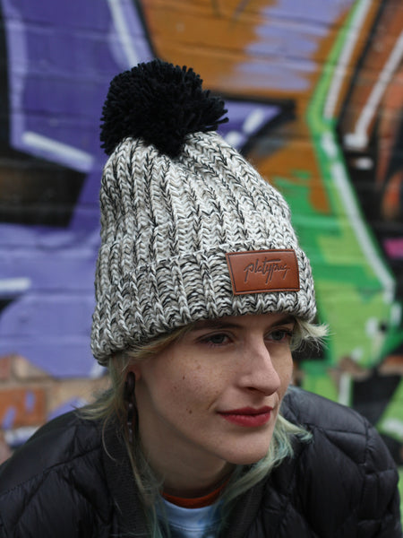 Model shot of Platypus Oatmeal Knit Thermal Beanie