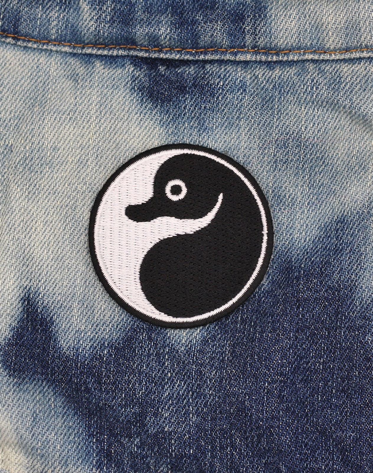 School of Platypus Yin Yang Iron on patch badge on denim jacket