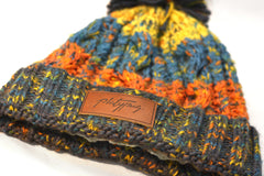 Close up of Platypus UK leather patch on Retro Big Knit Beanie Hat