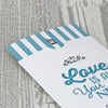 'Love Is All You Need' Wallet Wedding Invitation Close Up