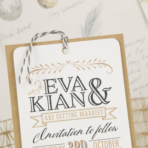 save the date tag tied with twine