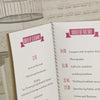 Close up of 'All You Need' Kraft with Ivory Inserts Wedding Order of Service