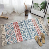 Vintage hand-woven rug, made of cotton and linen, beige with blue and red lines and figures