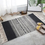 Vintage hand-woven rug, made of cotton and linen, black with beige lines and geometric figures