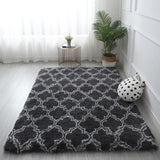 fluffy rug with black geometric patterns